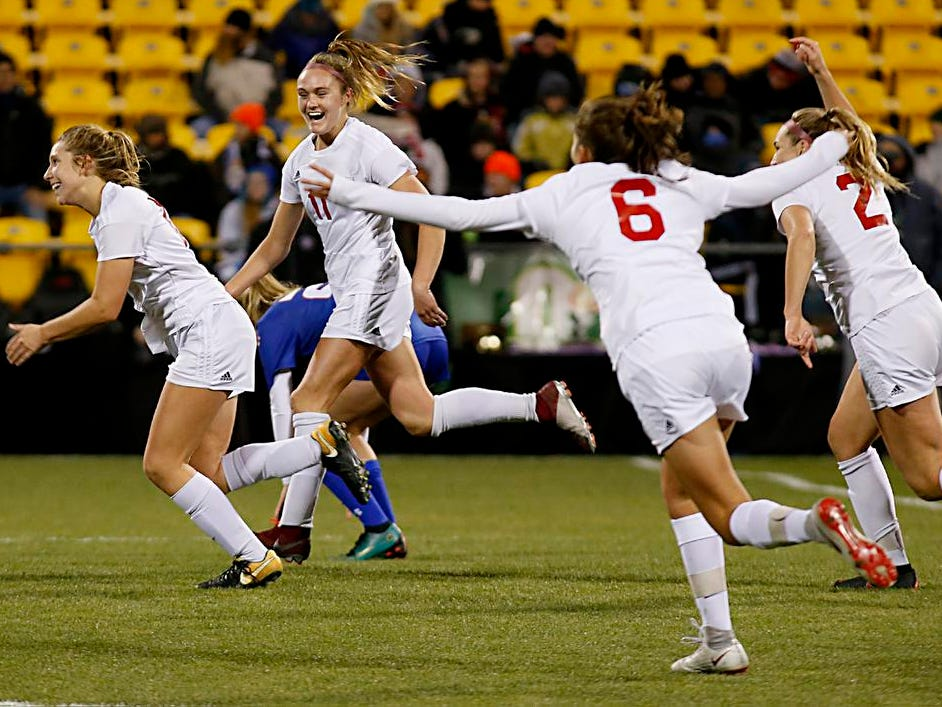 Indian Hill reacts as time runs out, giving them a victory in their Division II Championship soccer game against Bay Village Bay at MAPFRE Stadium in Columbus Friday, Nov. 9, 2018.