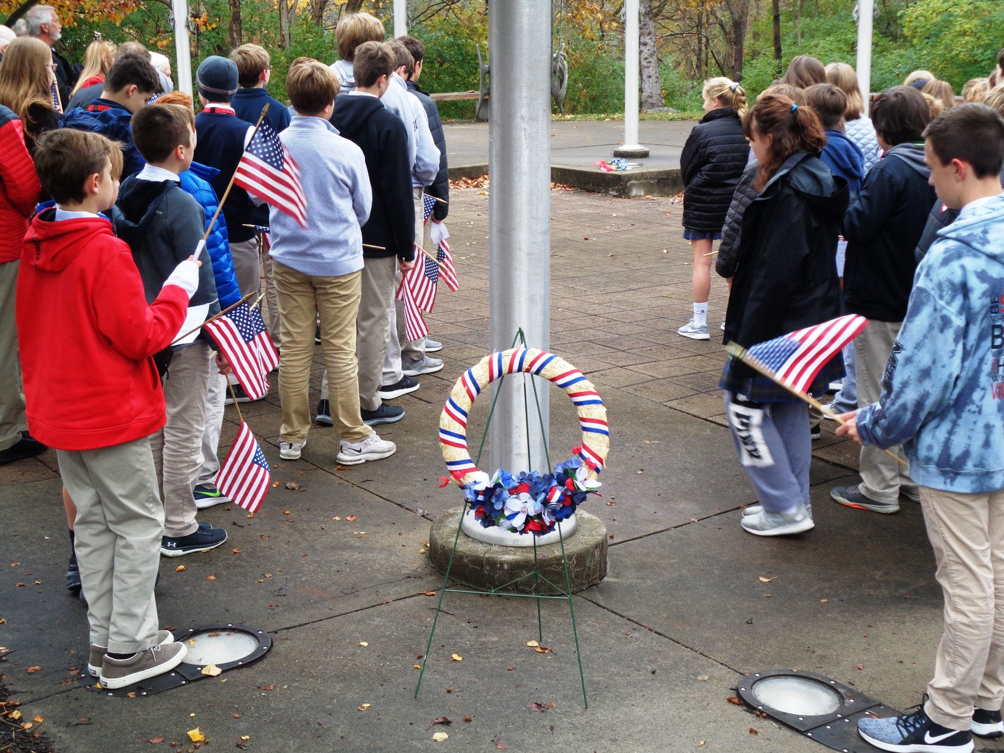 Students placed a wreath at the base of the American flag to honor all who have lost their lives in service to our country Nov. 9, 2018.