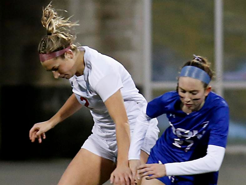 Indian Hill midfielder Bryn Wirthlin tries to steal from Bay Village Bay midfielder Alexis Knapp during their Division II Championship soccer game at MAPFRE Stadium in Columbus Friday, Nov. 9, 2018.