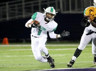 Hamilton Badin running back Davon Starks runs the ball during their playoff game against Alter, Friday, Nov. 9, 2018.