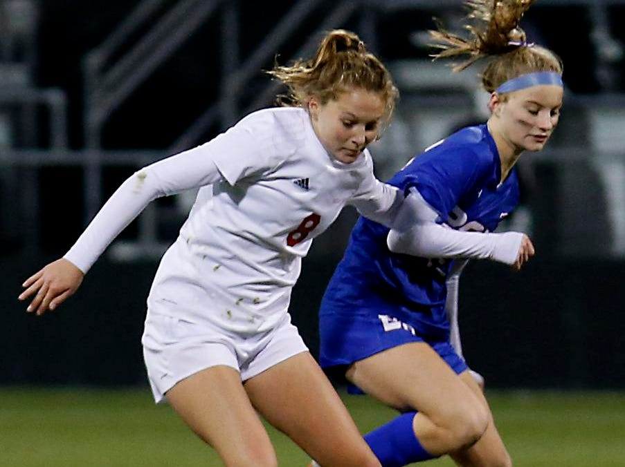 Indian Hill defender Maddie Miller tries to hold off Bay Village Bay midfielder Abby Smith during their Division II Championship soccer game at MAPFRE Stadium in Columbus Friday, Nov. 9, 2018.