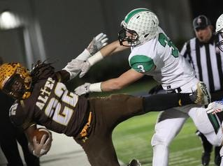 Kettering Alter running back Brandon McDonald(22) is knocked out of bounds by Hamilton Badin defensive back Keegan Gormley during their playoff game, Friday, Nov. 9, 2018.