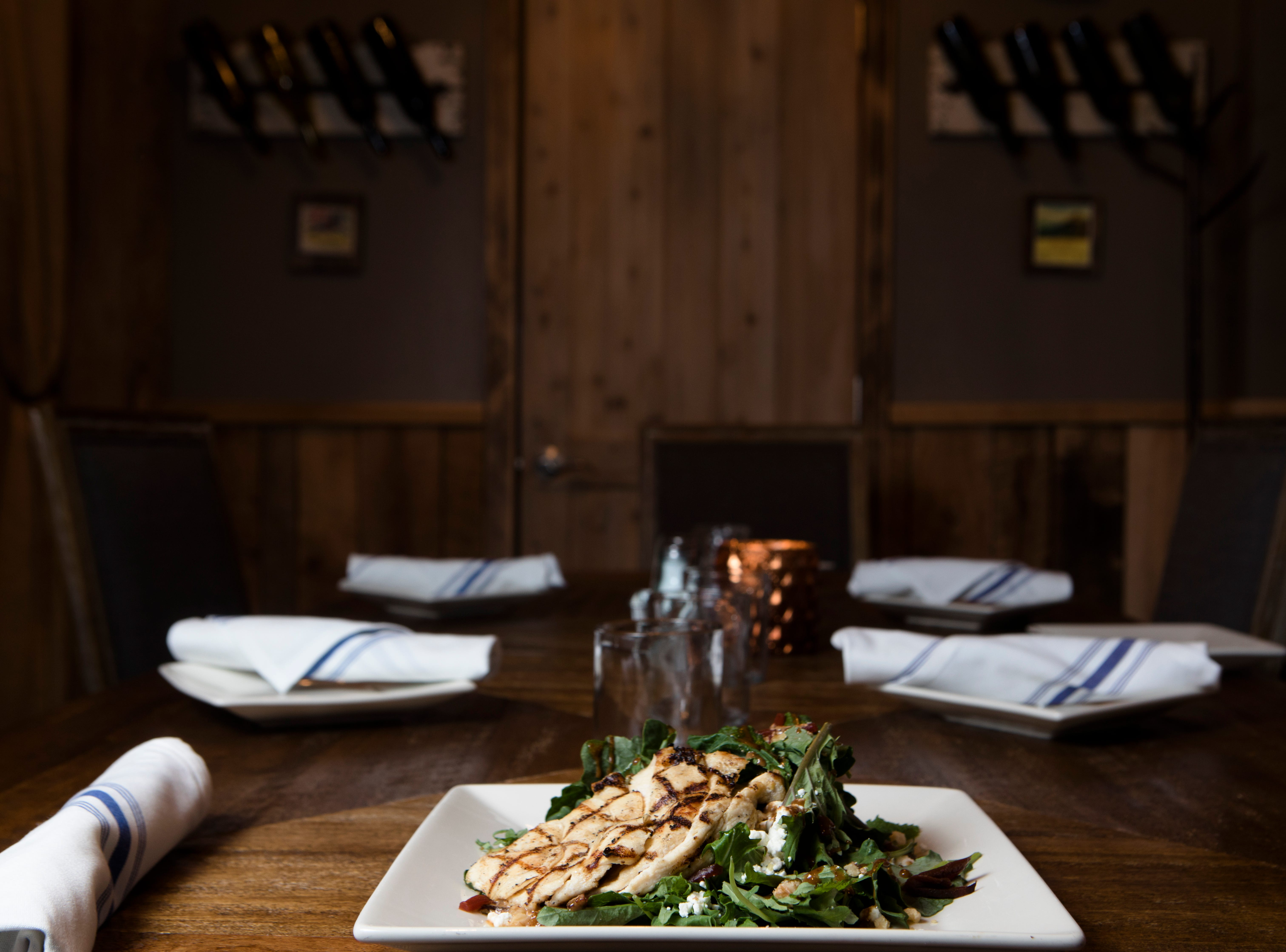 Baby Kale and Beet Grilled Chicken Salad made with sweet baby kale, julienne beets, crumbled goat cheese, toasted walnuts, char-grilled chicken breast, balsamic honey Dijon dressing at Napa kitchen + bar on Friday, Nov. 9, 2018.