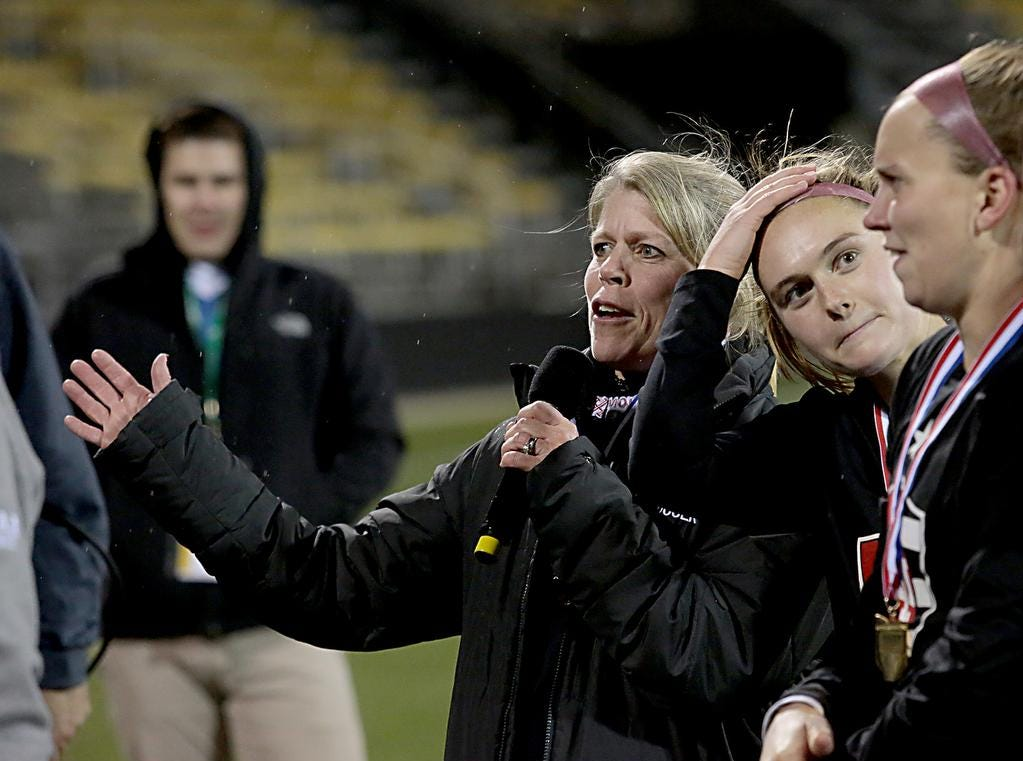 Indian Hill head coach Amy Dunlap speaks to the crowd after her team defeated Bay Village Bay in their Division II Championship soccer game at MAPFRE Stadium in Columbus Friday, Nov. 9, 2018.