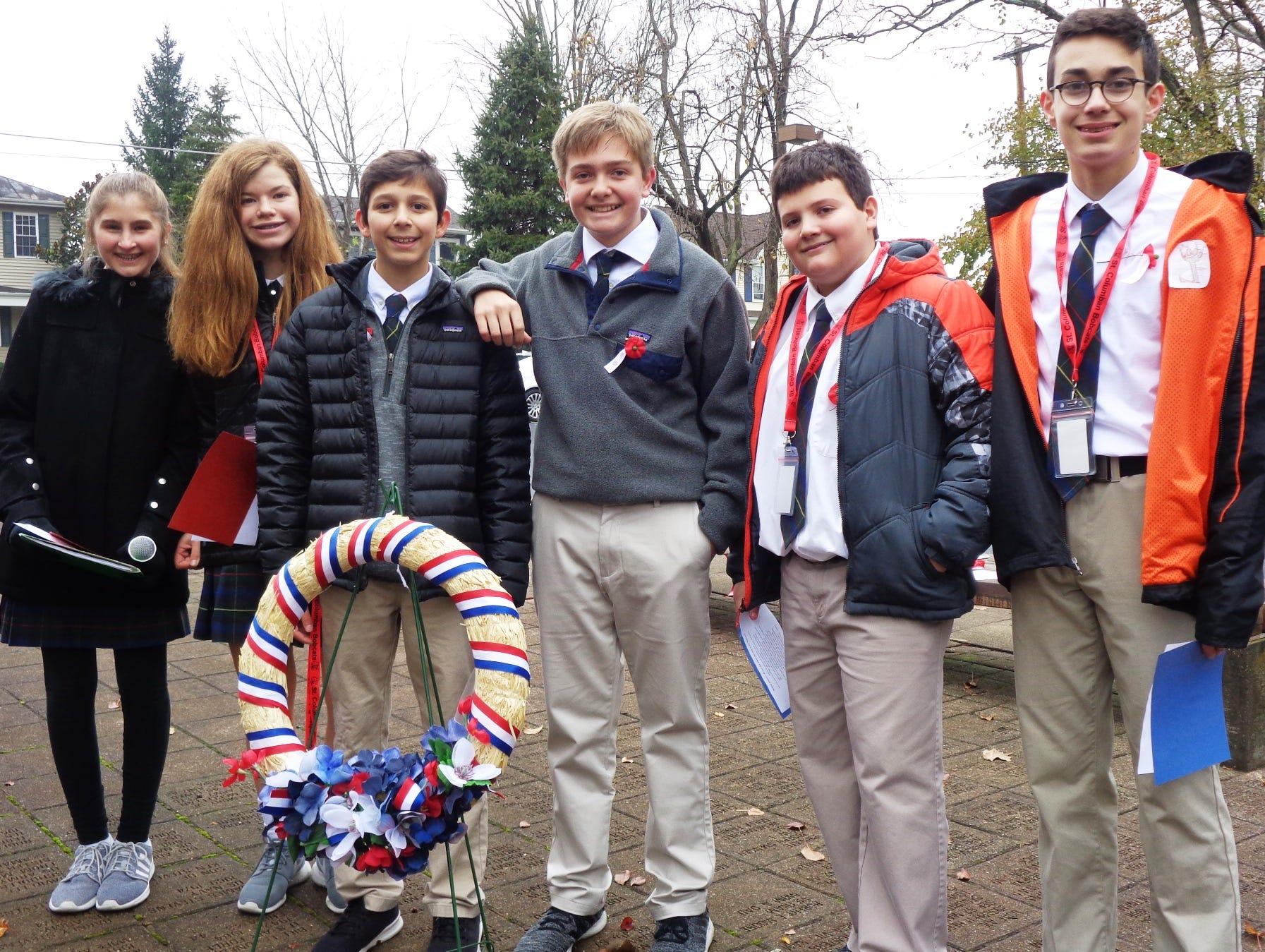 Ella Skolnicki, Sophie Seavey, Dominic Infantino, Sam Hawkins, Nick Worpenberg and Teddy Andrews, St. Columban eighth-grade Student Council, led the Veteran's Day ceremony in Loveland.