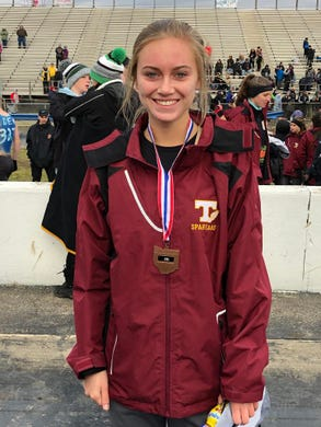 Turpin High School's Samantha Bush poses for a photo after receiving her 4th place medal at the 2018 Girls Division I Cross Championships, November 10, 2018 at National Trail Raceway Center in Hebron, Ohio