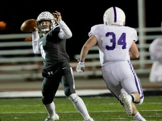 Lakota East quarterback Sean Church (4) throws a pass during the second round Division I playoff football game between Elder and Lakota East on Friday, Nov. 9, 2018 in Mason.