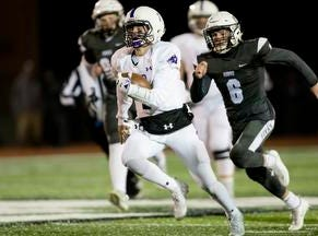 Elder quarterback Matthew Luebbe  (7) runs downfield during the second round Division I playoff football game between Elder and Lakota East on Friday, Nov. 9, 2018 in Mason.