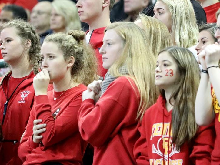 Bishop Fenwick fans cheer on the Falcons during their state semi-final game against Holy Name, Friday, Nov. 9, 2018.