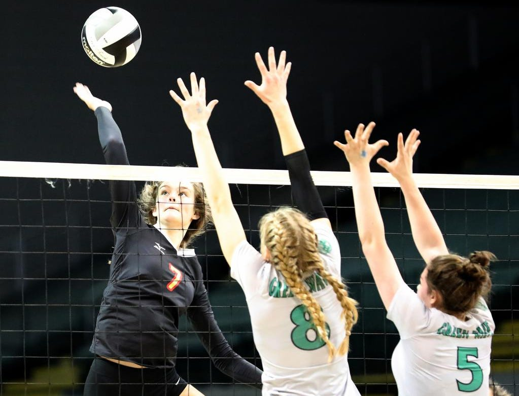 Bishop Fenwick  player Elizabeth Hoerlein goes for a kill during  the Falcons  their state semi-final game against Holy Name, Friday, Nov. 9, 2018.