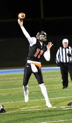 Quarterback David Thompson delivers a strike for Anderson as the Redskins move on to the OHSAA Division II Region Championship, November 9, 2018.