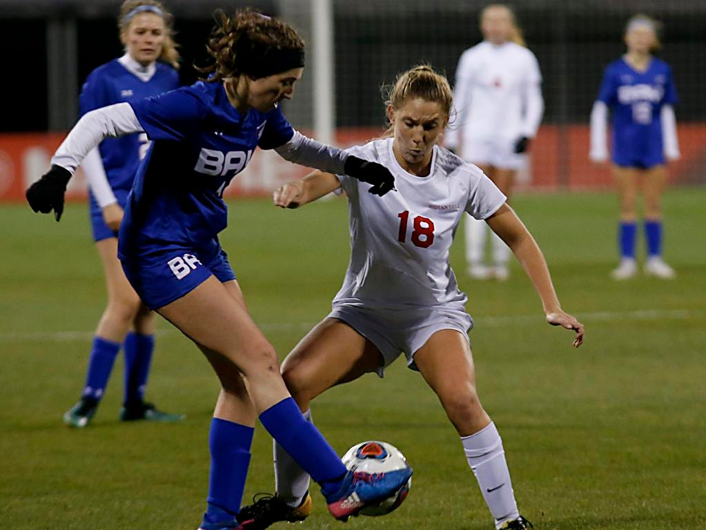 Bay Village Bay forward Avery Alexy beats Indian Hill midfielder Ellie Podojil to the ball during their Division II Championship soccer game at MAPFRE Stadium in Columbus Friday, Nov. 9, 2018.
