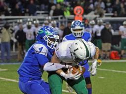 Winton Woods DB Mi'quan Grace tackles Little Miami's Avery Harris for a loss. Winton Woods defeated Little Miami 38-12.