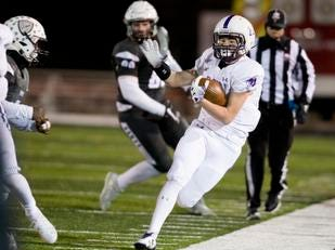 Elder running back Joe Catania  (21) runs out of bounds during the second round Division I playoff football game between Elder and Lakota East on Friday, Nov. 9, 2018 in Mason.