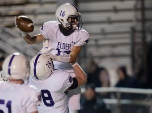 Elder offensive lineman Jakob James  (78) lifts up Elder wide receiver Kyle Trischler  (16) after he scored a touchdown during the second round Division I playoff football game between Elder and Lakota East on Friday, Nov. 9, 2018 in Mason.