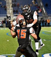 Ethan Hamilton (10) and Conner Brondhaver (15) defend for Anderson on a Troy pass and catch at the OHSAA Division II Region Semifinal, November 9, 2018.