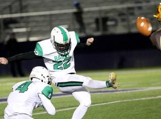 Hamilton Badin kicker Luke Vansteenkiste attempts a field goal during the Rams playoff game against Kettering Alter, Friday, Nov. 9, 2018.