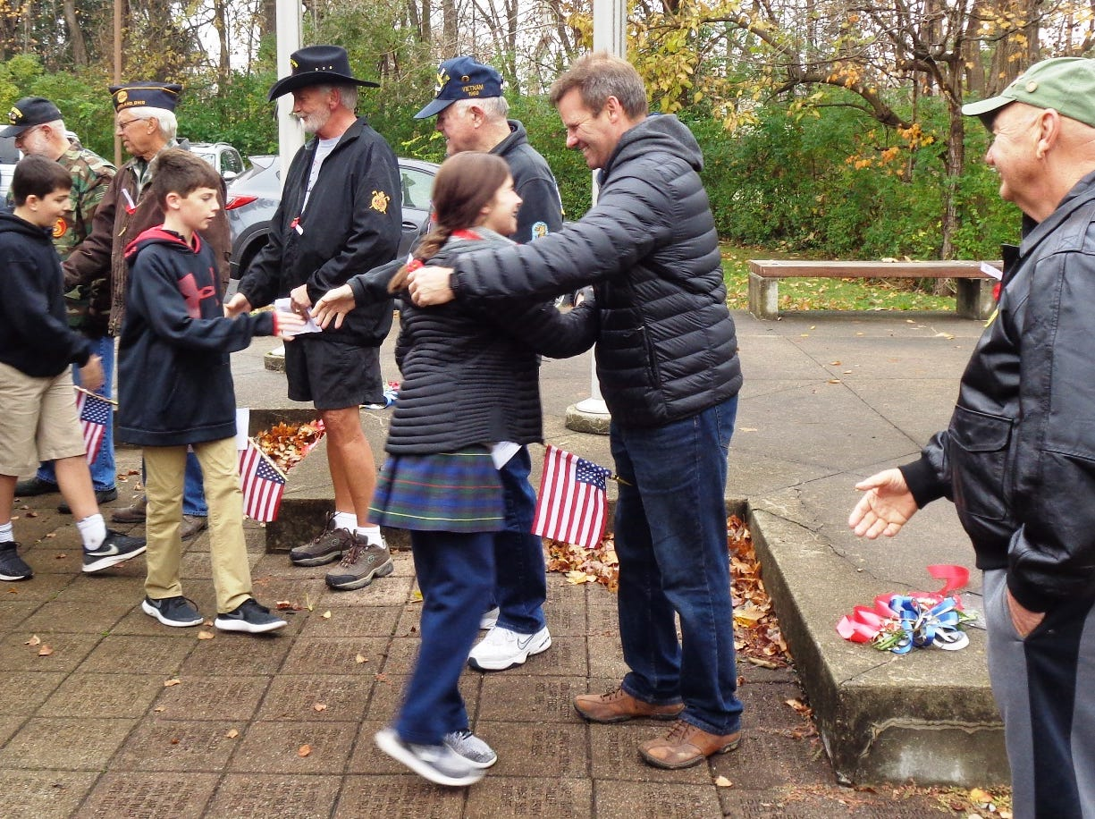 Spontaneous hugs and handshakes of thanks were shared with the veterans and students at the close of the Veterans Day ceremony in Loveland, Ohio Friday, Nov. 9, 2018.