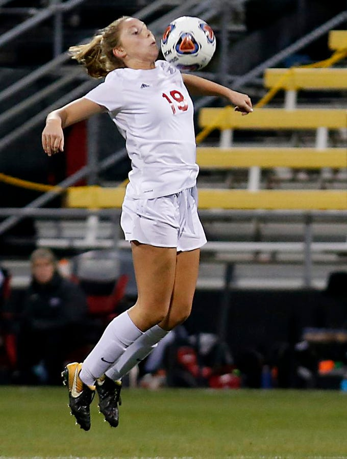 Indian Hill midfielder Ellie Podojil collects the ball against Bay Village Bay during their Division II Championship soccer game at MAPFRE Stadium in Columbus Friday, Nov. 9, 2018.