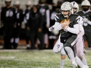 Lakota East running back Sean Church (4) runs downfield during the second round Division I playoff football game between Elder and Lakota East on Friday, Nov. 9, 2018 in Mason.