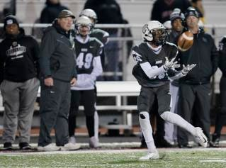 Lakota East wide receiver Salah Rammouz (26) catches a pass during the second round Division I playoff football game between Elder and Lakota East on Friday, Nov. 9, 2018 in Mason.