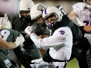 Lakota East linebacker Hayden King (33) tackles Elder quarterback Matthew Luebbe  (7) during the second round Division I playoff football game between Elder and Lakota East on Friday, Nov. 9, 2018 in Mason.