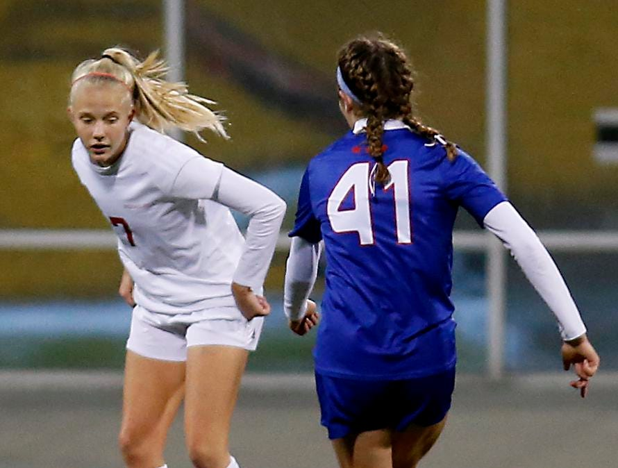 Indian Hill midfielder Ashleigh Prugh tries to impede Bay Village Bay midfielder Olivia Reed during their Division II Championship soccer game at MAPFRE Stadium in Columbus Friday, Nov. 9, 2018.