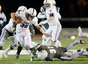 Elder running back Cooper Johnson  (39) is tackled on Lakota East defensive back Dylan Sawyer (31) during the second round Division I playoff football game between Elder and Lakota East on Friday, Nov. 9, 2018 in Mason.