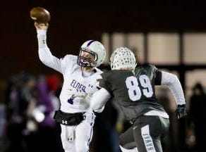Elder quarterback Matthew Luebbe  (7) throws a pass during the second round Division I playoff football game between Elder and Lakota East on Friday, Nov. 9, 2018 in Mason.