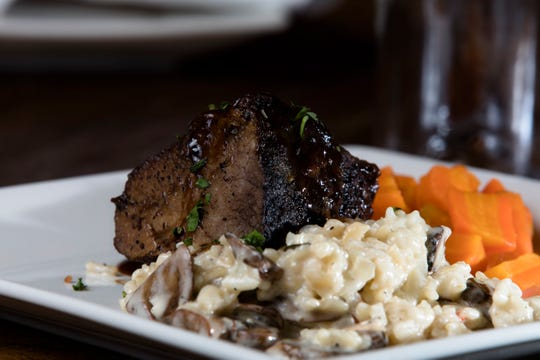 The Beef Short Ribs served with port wine demi-glace, roasted mushroom risotto and glazed carrots at Napa kitchen + bar on Friday, Nov. 9, 2018.