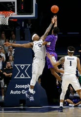 Xavier Musketeers forward Tyrique Jones (0) attempt to block a shot by Evansville Aces guard Marty Hill (1) in the second half of the NCAA basketball game between the Xavier Musketeers and the Evansville Aces at the Cintas Center in Cincinnati on Saturday, Nov. 10, 2018. Xavier improved to 2-0 on the season with a 91-85 win.