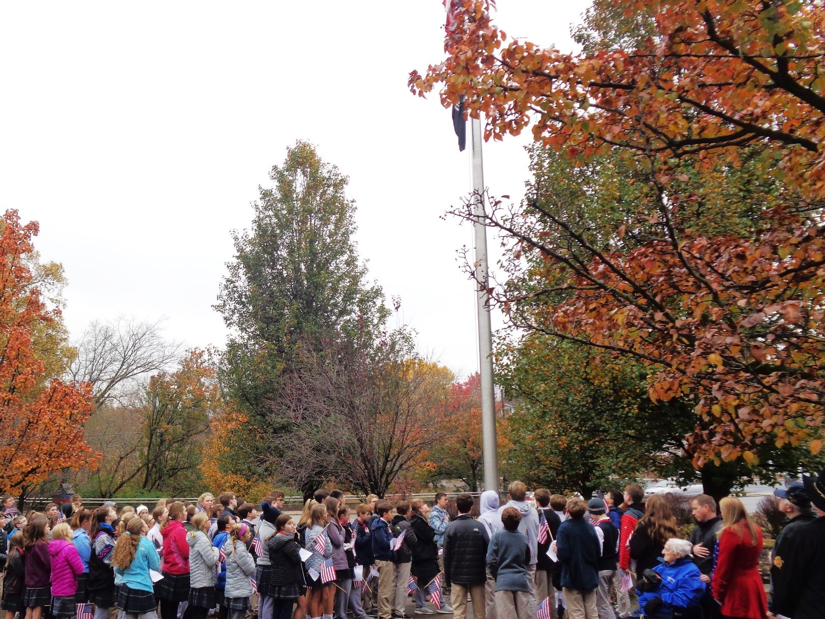 Students and the crowd stood at attention for the National Anthem at the start of the Veterans Day Celebration at Loveland Veteran's Memorial Park Friday, Nov. 9, 2018.