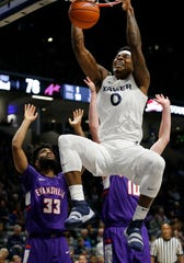 Xavier Musketeers forward Tyrique Jones (0) throws down another dunk in the second half of the NCAA basketball game between the Xavier Musketeers and the Evansville Aces at the Cintas Center in Cincinnati on Saturday, Nov. 10, 2018. Xavier improved to 2-0 on the season with a 91-85 win.