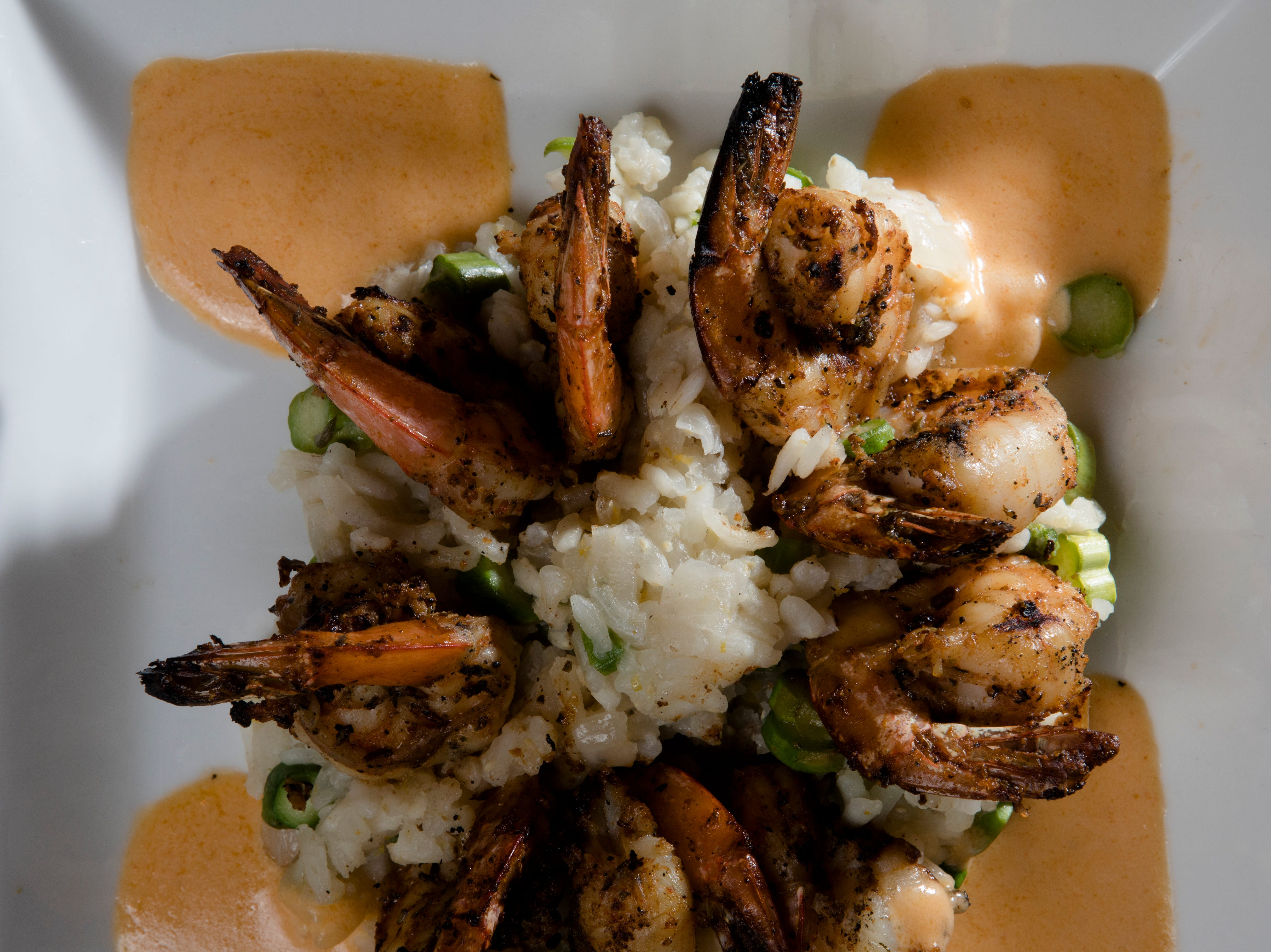 Grilled Shrimp served with citrus risotto, asparagus, char-grilled shrimp, Sriracha cream and mozzarella at Napa kitchen + bar on Friday, Nov. 9, 2018.