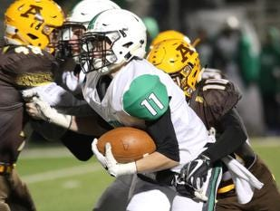 Hamilton Badin wide receiver  Joshua Hegermann (11) runs the ball during their playoff game against Kettering Alter, Friday, Nov. 9, 2018.