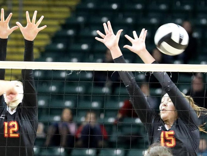 Bishop Fenwick players Julia Gardon and  Kate Hafer defend the net  during their state semi-final game against Holy Name, Friday, Nov. 9, 2018.