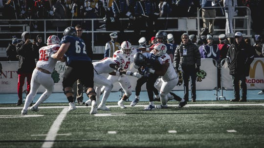 Austin Peay's defense makes a stop on an Eastern Illinois player during their Ohio Valley Conference game Saturday.