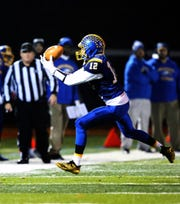 North Brunswick's Aaron Ahr catches a pass against Edison during the first half of a Central Group V semifinal on Friday,  Nov. 9, 2018.