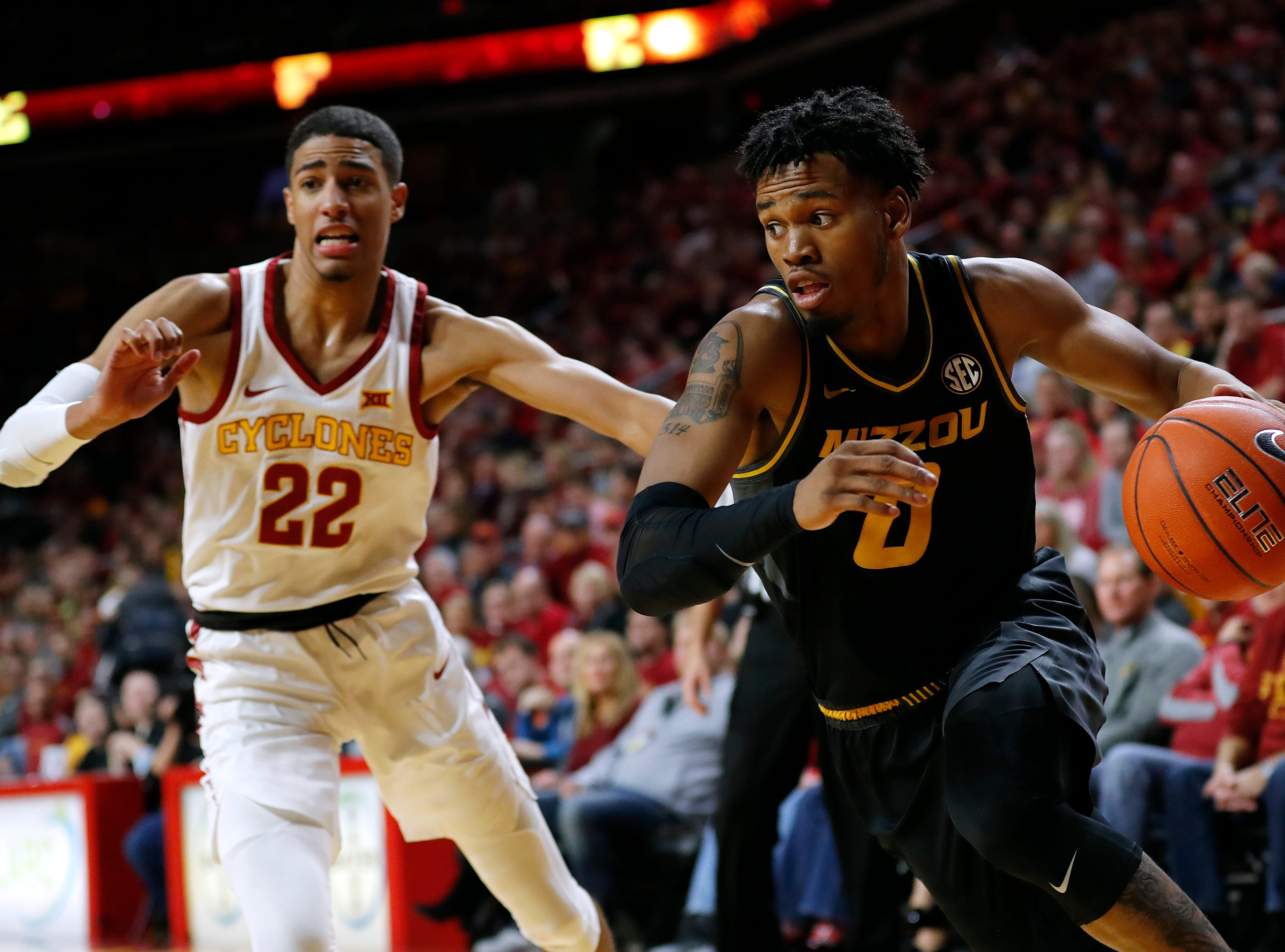 Missouri guard Torrence Watson drives to the basket past Iowa State guard Tyrese Haliburton (22) during the second half of an NCAA college basketball game, Friday, Nov. 9, 2018, in Ames, Iowa.