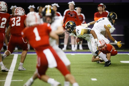 Southeast Polk's Gavin Williams (21) can't escape the tackle of Cedar Falls's Chip Custer (28) during their 4A state football semi-final game on Friday, Nov. 9, 2018, in Cedar Falls. Cedar Falls would go on beat Southeast Polk 26-12 to advance to the finals next week.