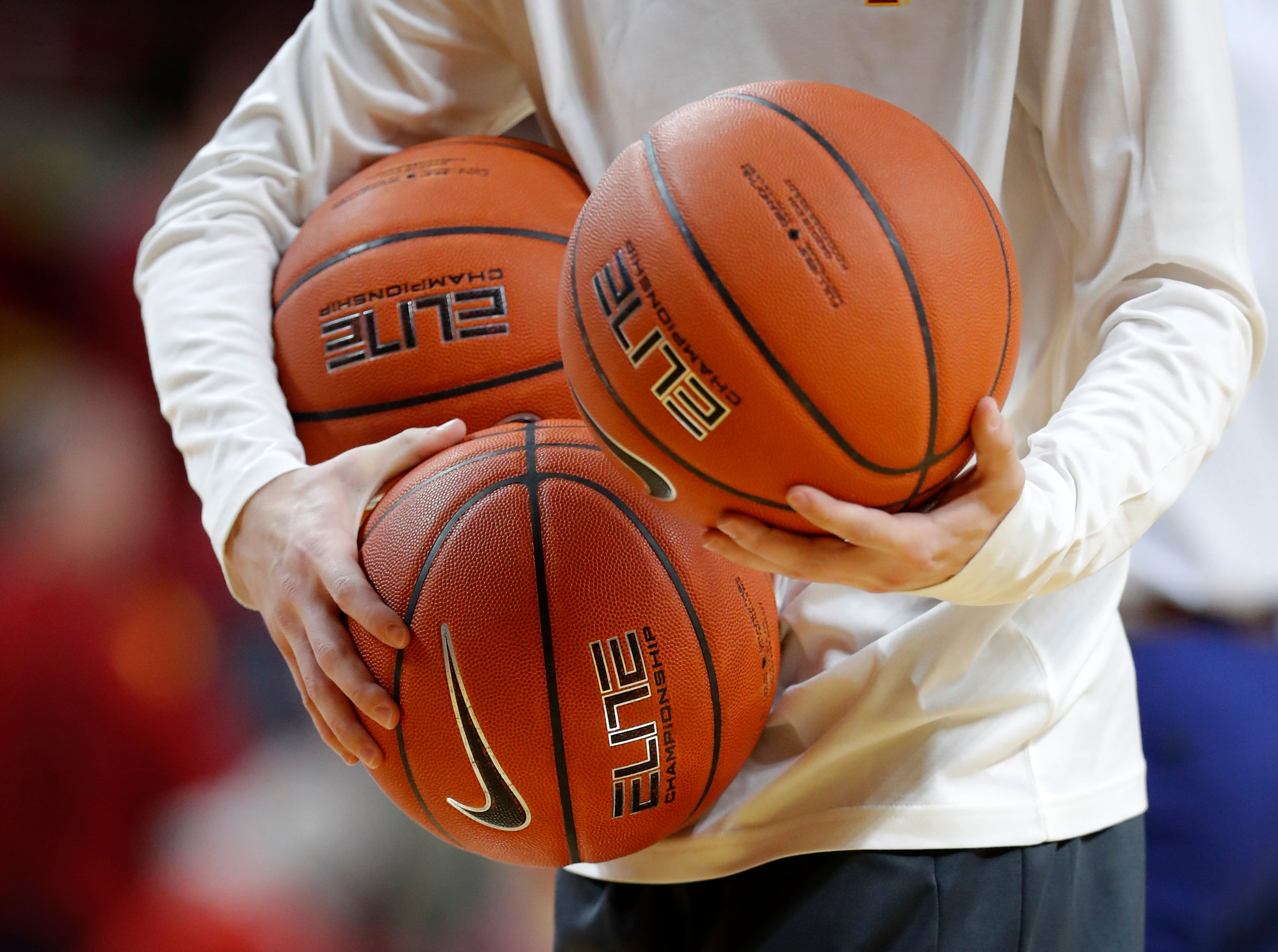 An Iowa State manage holds basketballs before an NCAA college basketball game between Iowa State and Missouri, Friday, Nov. 9, 2018, in Ames, Iowa.