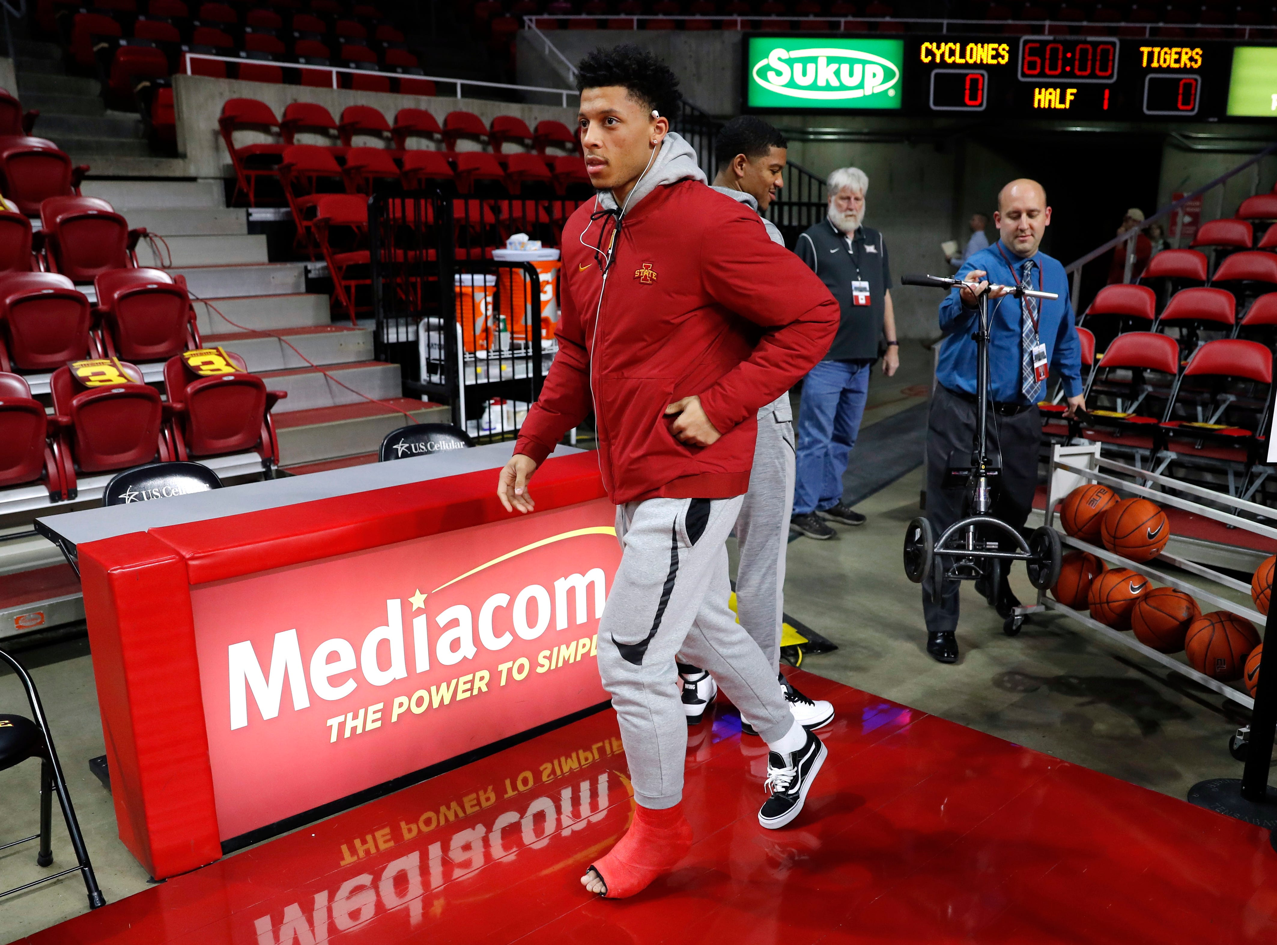 Injured Iowa State guard Lindell Wigginton walks onto the court before an NCAA college basketball game against Missouri, Friday, Nov. 9, 2018, in Ames, Iowa.
