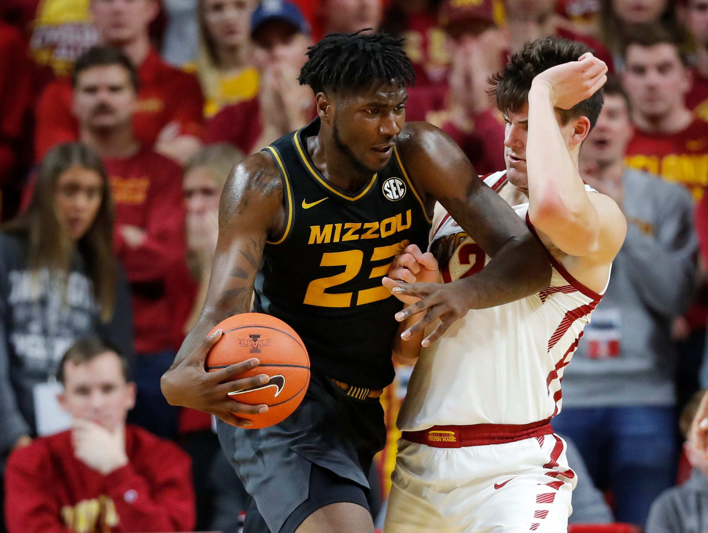 Missouri forward Jeremiah Tilmon (23) drives around Iowa State forward Michael Jacobson during the first half of an NCAA college basketball game, Friday, Nov. 9, 2018, in Ames, Iowa.