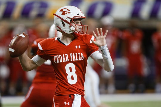 Cedar Falls's Cael Loecher (8) passes during their 4A state football semi-final game against Southeast Polk on Friday, Nov. 9, 2018, in Cedar Falls. Cedar Falls takes a 10-6 lead into halftime.