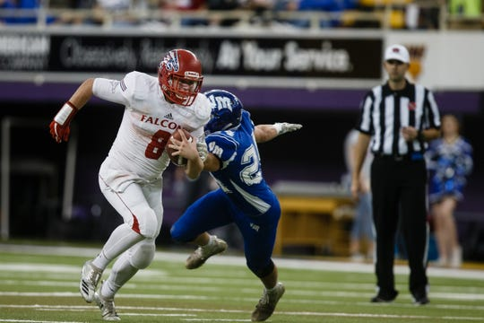West Sioux, Hawarden's Hunter Dekkers (8) looks for an opening during their 1A state football semi-final game on Saturday, Nov. 10, 2018, in Cedar Falls. West Sioux takes a 24-21 lead over Van Meter into half-time.