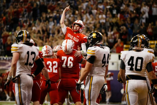 Cedar Falls's Cael Loecher (8) is lifted after scoring a touchdown to make the score 26-12 during their 4A state football semi-final game on Friday, Nov. 9, 2018, in Cedar Falls. Cedar Falls would go on beat Southeast Polk 26-12 to advance to the finals next week.