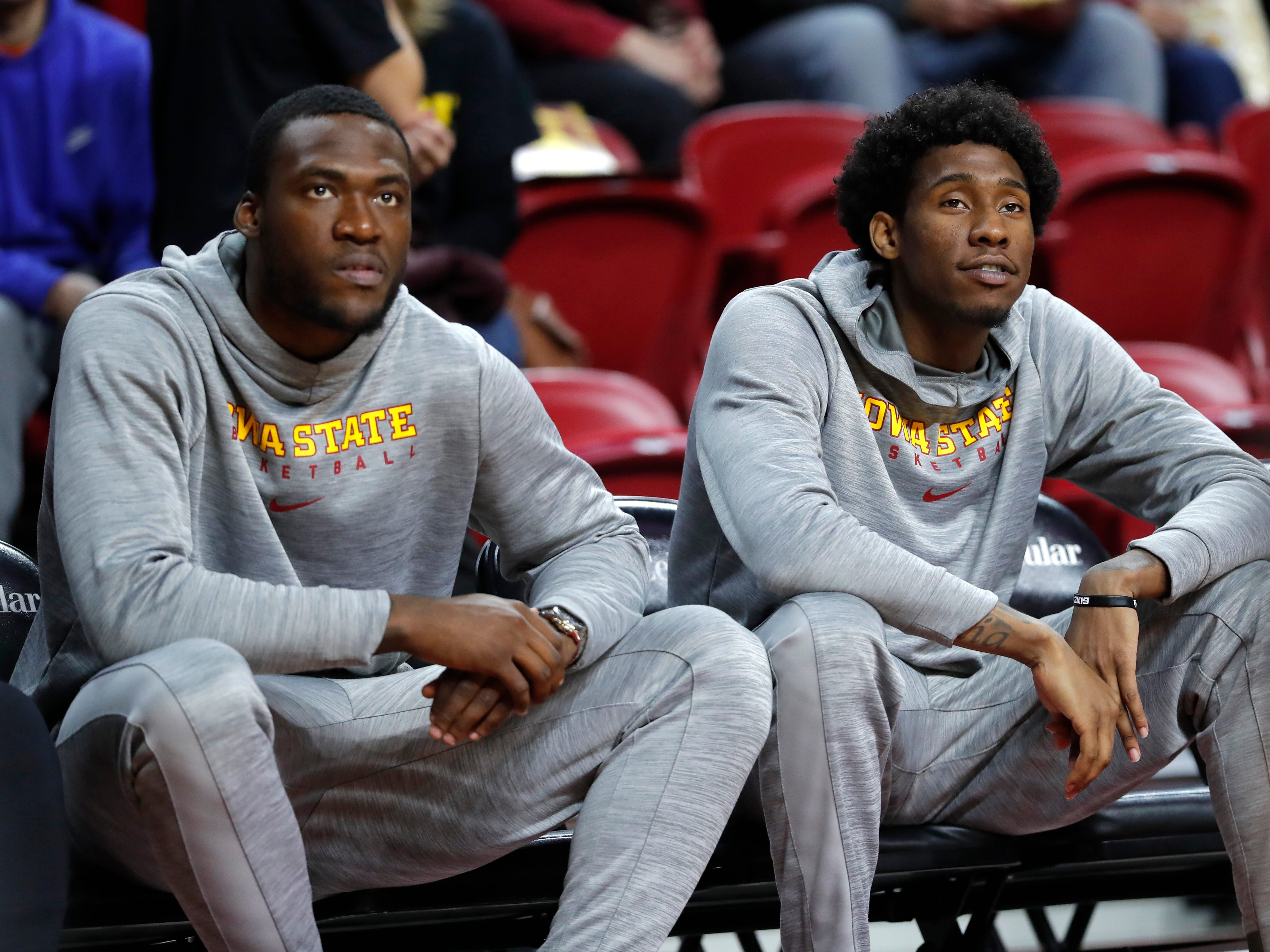 Iowa State forward Cameron Lard, left, and forward Zoran Talley Jr. sit on the bench before an NCAA college basketball game against Missouri, Friday, Nov. 9, 2018, in Ames, Iowa.