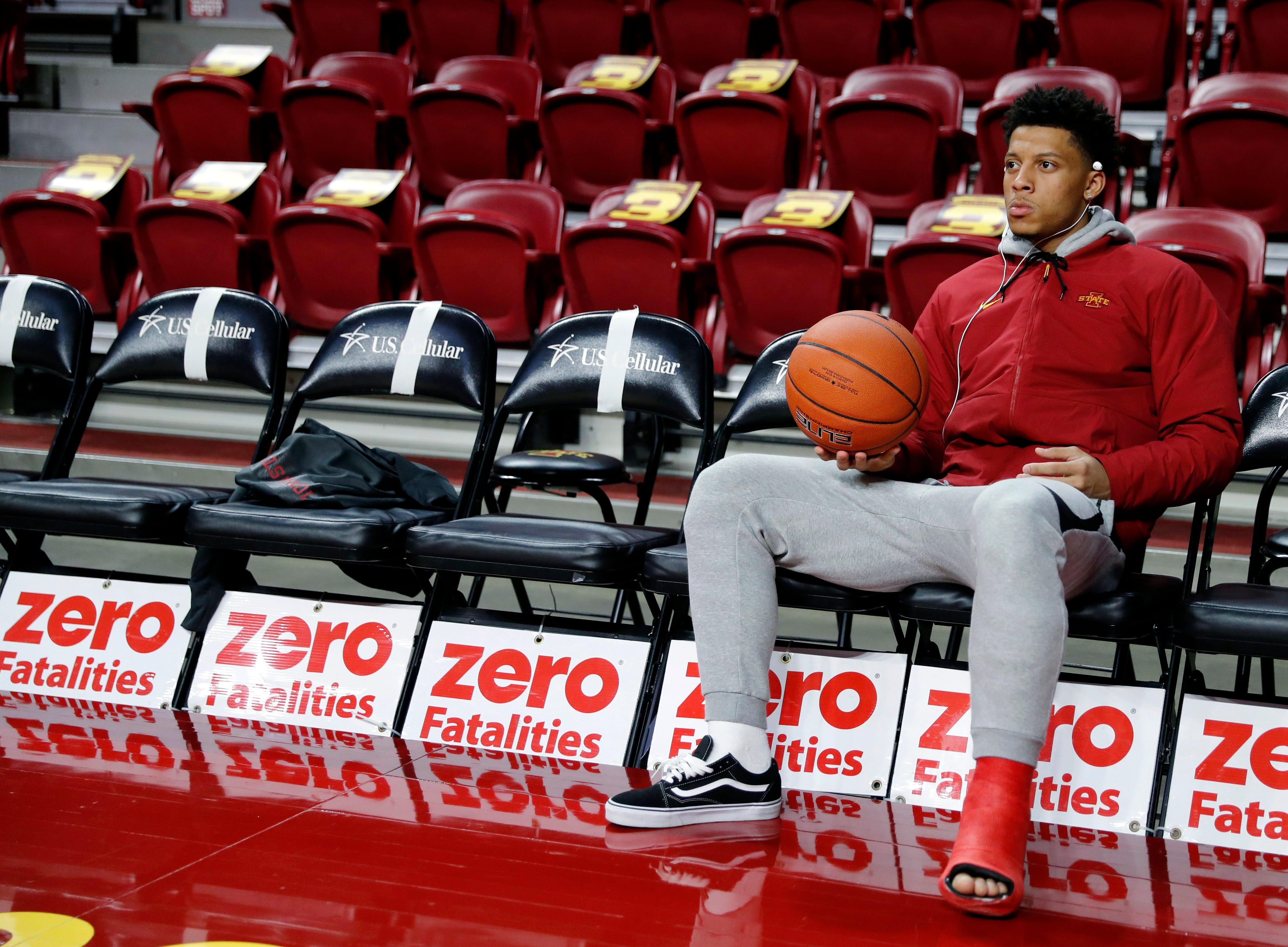 Injured Iowa State guard Lindell Wigginton sits on the bench before an NCAA college basketball game against Missouri, Friday, Nov. 9, 2018, in Ames, Iowa.