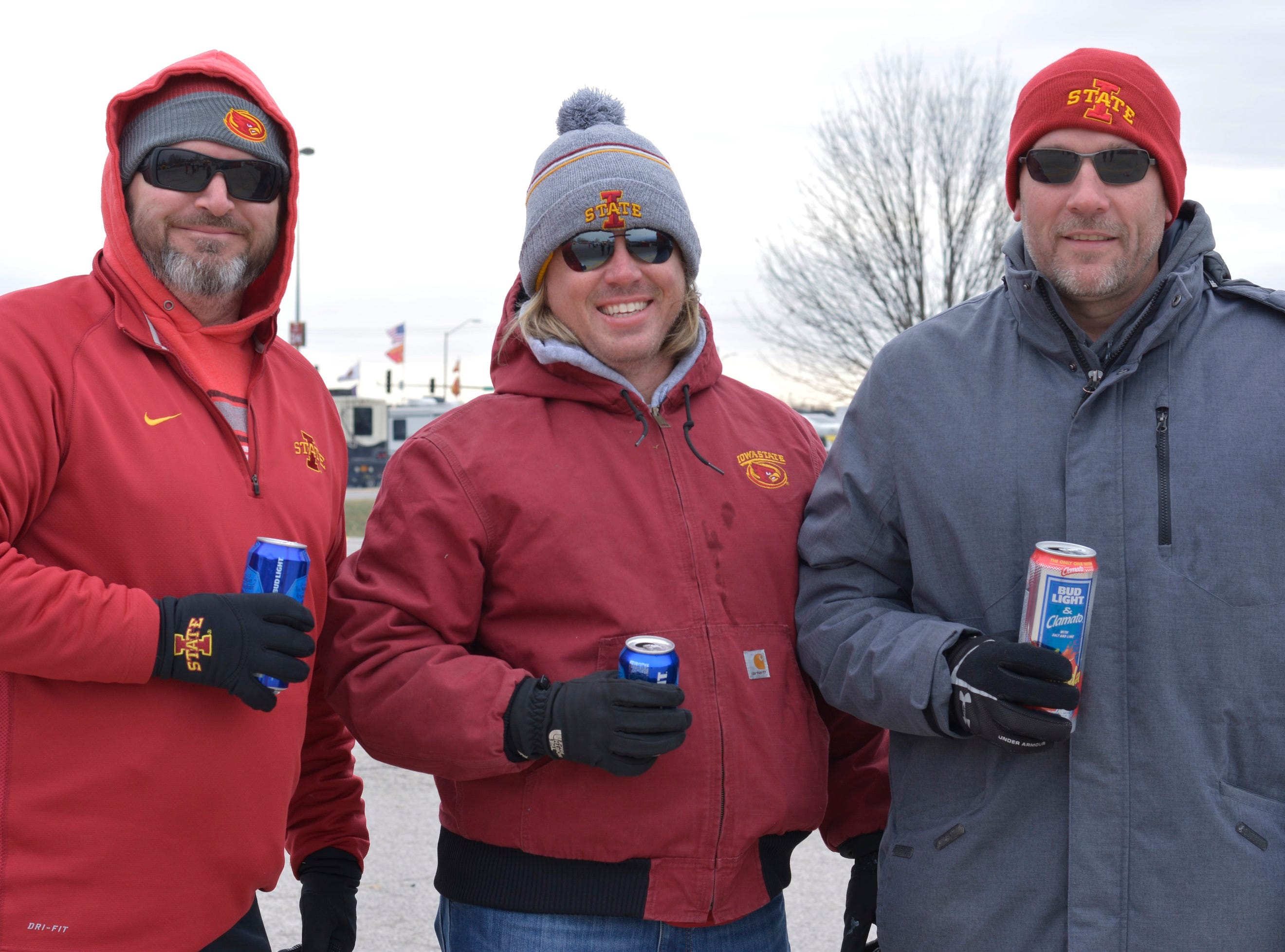 Rick Morgan (left), Jason Ammons (middle) and Chad Meyer (right) before the Iowa State University football game against Baylor in Ames on Nov. 10.