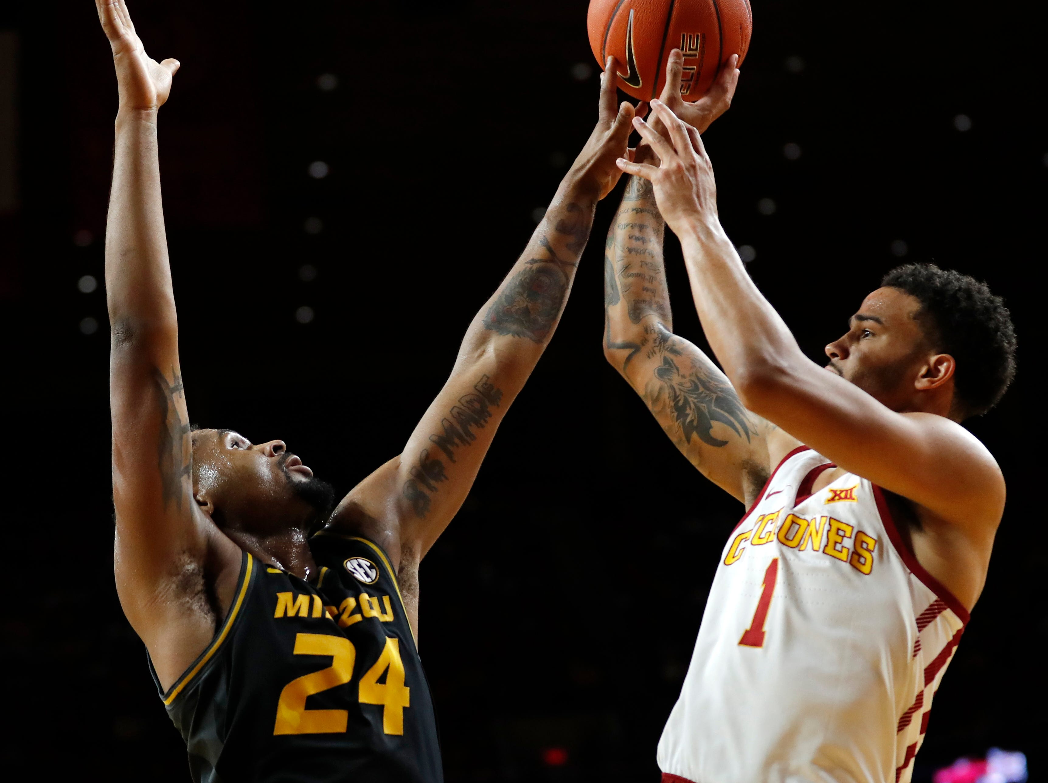 Iowa State guard Nick Weiler-Babb (1) is fouled by Missouri forward Kevin Puryear (24) during the first half of an NCAA college basketball game, Friday, Nov. 9, 2018, in Ames, Iowa.